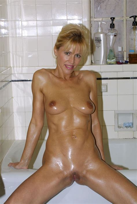 Horny Oiled Up Blonde Mature In Bathroom Clearly