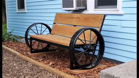 wagon wheel bench wagon wheel bench in front of house