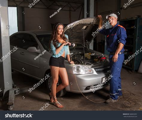 Beautiful Girl Auto Mechanic Standing Near Stock Photo
