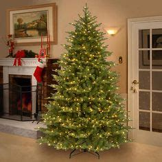 living 9 ft pre lit mckenney fir artificial tree with 1450 count white