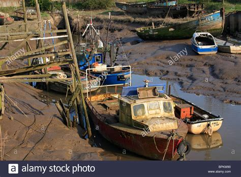 Old Fishing Boats For Sale Uk by Old Fishing Boats In A Muddy Berth Adjacent To A Rickety