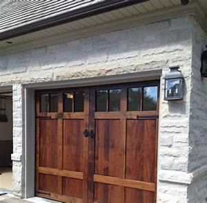 Bringing sliding barn doors inside for Barnyard garage doors