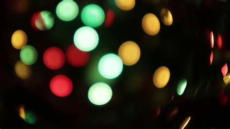 blurred colorful christmas lights on black background with