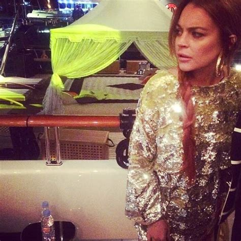 lindsay lohan living    cannes topless selfies private jets  partying   yacht