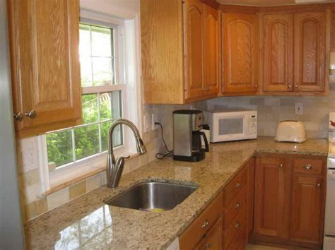 honey oak kitchen cabinets with granite countertops marble countertops with honey oak cabinets google search