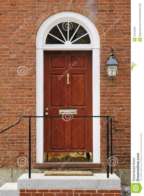 elegant front door   brick building stock images