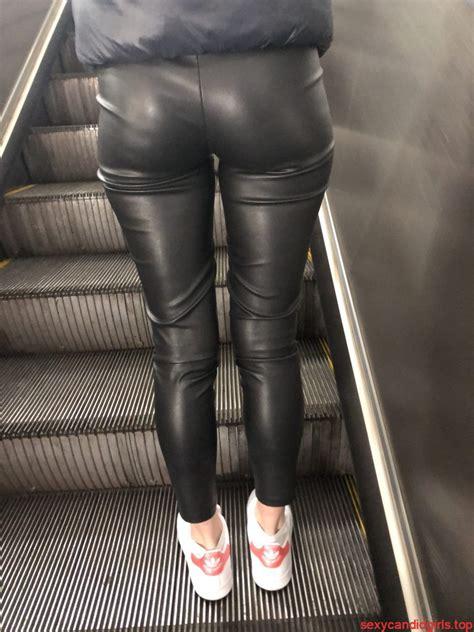 girl  leather leggings   subway escalator