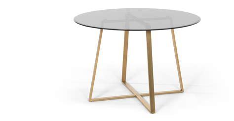 smoked glass dining table haku round large dining table brass and smoked glass
