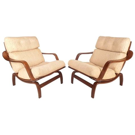 mid century modern lounge chairs in the style of bruno