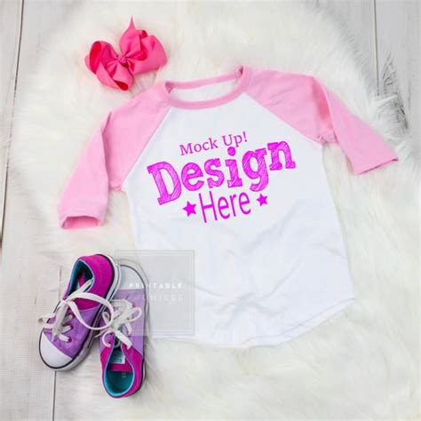 The mockup shows the front and back of a gray hoodie: Pink Raglan Mock up T Shirt Mock up Youth Raglan Flatlay ...