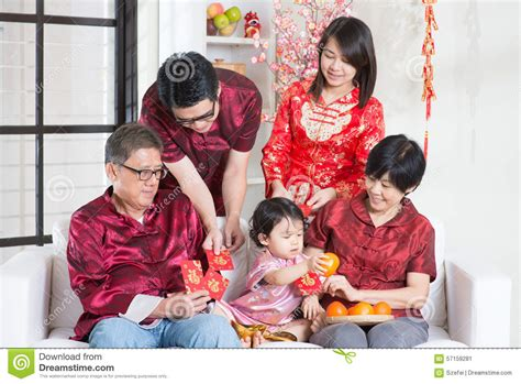 New Celebrate Family Friends Life: Chinese New Year Giving Red Packets Stock Image