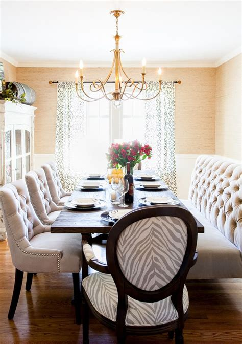 beautiful dining room adorned  brass chandelier