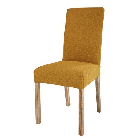 housse de chaise tissus housse de chaise en tissu ocre margaux maisons du monde