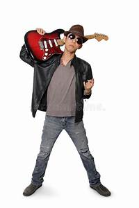 Young Rocker Carrying Guitar On His Shoulder Isolated On