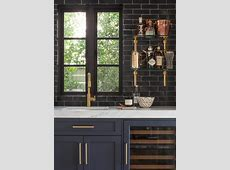 Glossy Black Wet Bar Backsplash with Glass and Brass