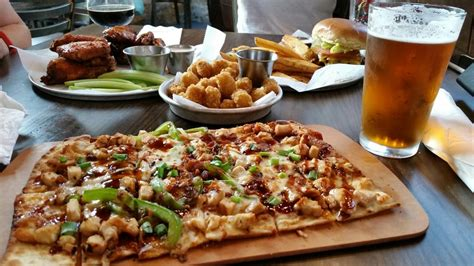 Chipotle Exton wings tots burger and chipotle bbq chicken flatbread