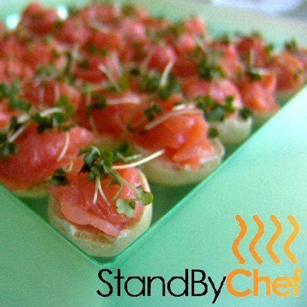 canape made roses of smoked salmon on half bagels for canapes