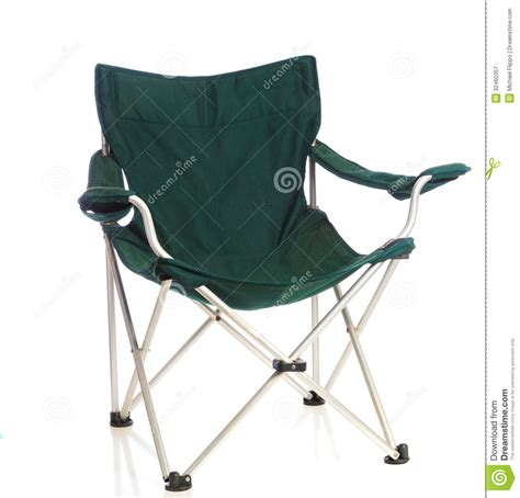 green folding lawn chair on white royalty free stock