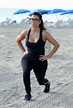 Kim Kardashian - Morning walk on the beach wearing a low ...