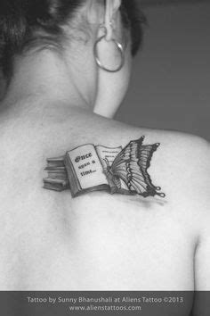 Open Book Tattoo | Knowledge Bursting From An Open Book On A Yellow Background by Eugene