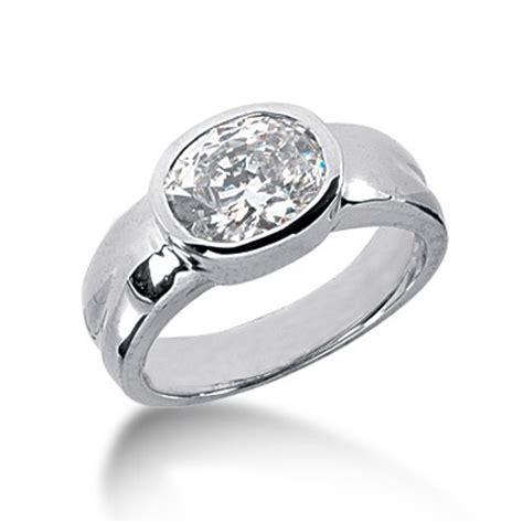 oval cut bezel set solitaire engagement ring