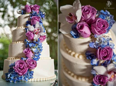 Ivory Four-tier Stacked Wedding Cake Adorned With Fuchsia
