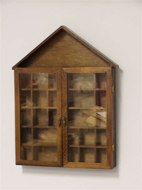 small wall curio cabinet small curio cabinet to hang on the wall oak by