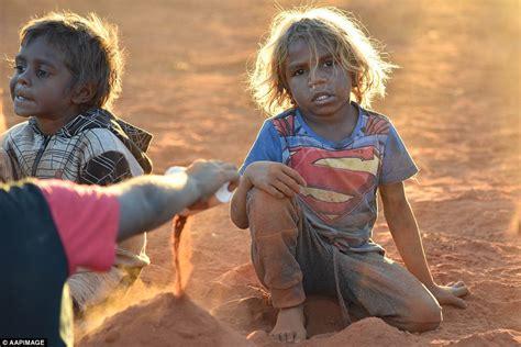 Aboriginal Australians Dance In Traditional Dress At Uluru  Daily Mail Online