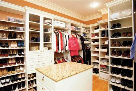 white master closet with island traditional closet
