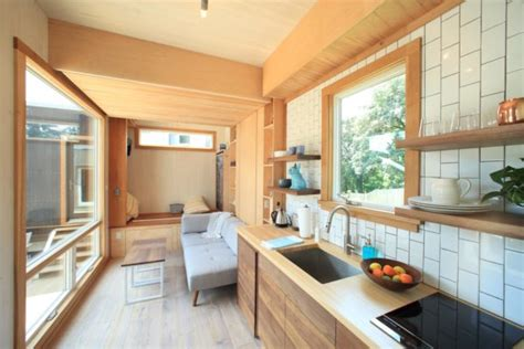 modern ft tiny house  secret ceiling bed  remote control gull wing door