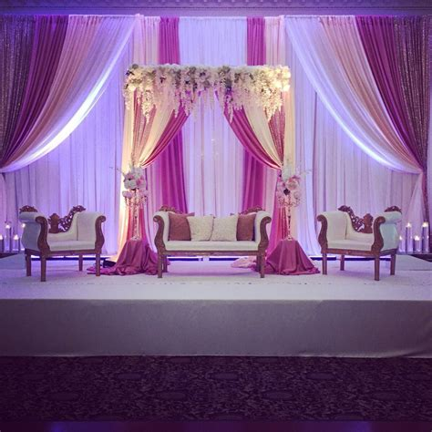 blush pink reception backdrop with florals wedding in
