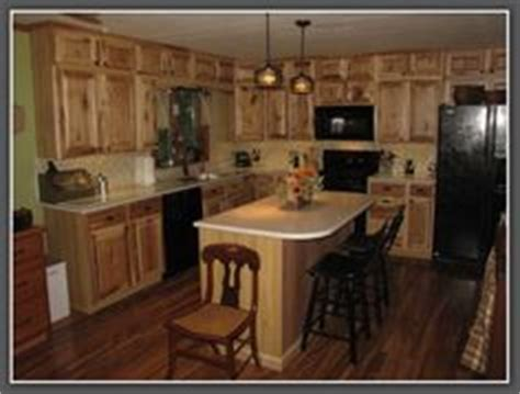 lowes hickory kitchen cabinets honey spice hickory cupboards using orange paint color 7215