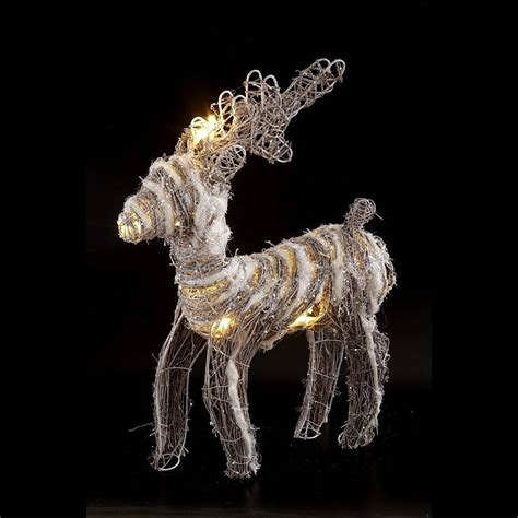 rattan reindeer with lights by little red heart