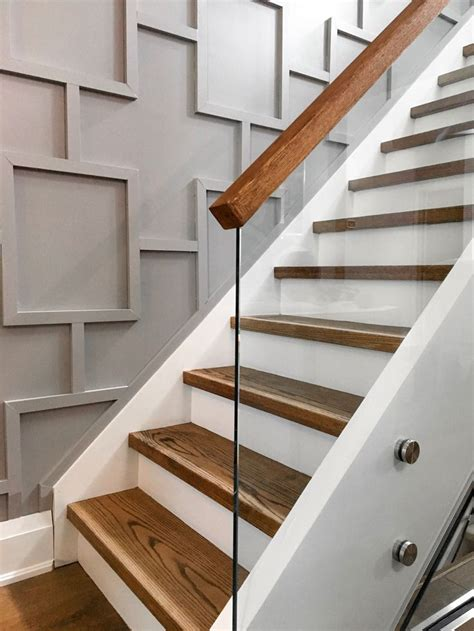 glass staircase  applied molding wall millwork