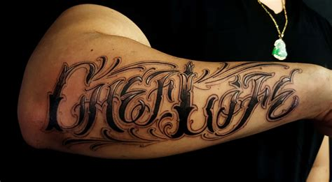 custom lettering chef life  outer forearm tattoo