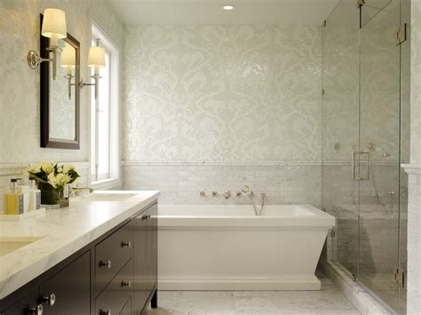 ivory tiles wallpapered walls frameless glass shower