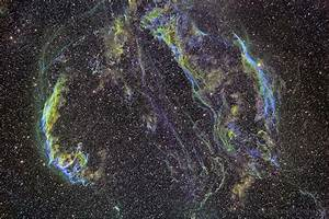 The Veil Nebula is a cloud of heated and ionized gas and ...