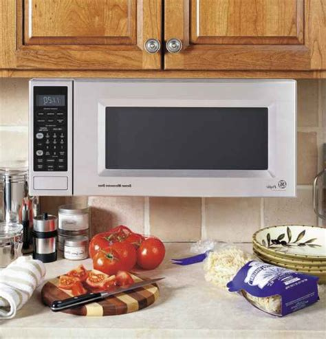 how to hang a microwave under a cabinet ge microwave under cabinet mounting kit bestmicrowave