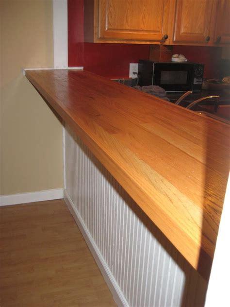 DIY bar top made with plywood, oak hardwood flooring, nail