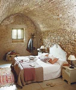 Natural rock wall for rustic bedroom ideas with simple bed