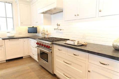 white kitchen cabinets with brick backsplash brick backsplash white kitchen white cabinets 2066
