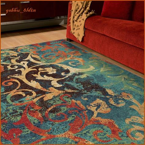 And Teal Rug by Unique Watercolor Scroll Area Rug Teal Blue Orange