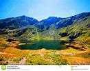 Balea Lake in Romania stock photo. Image of rough ...