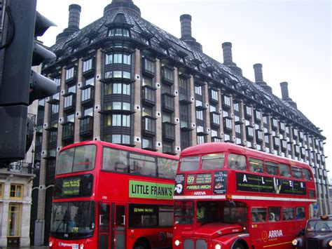 stock photo  red london buses  big building  street side photoeverywhere