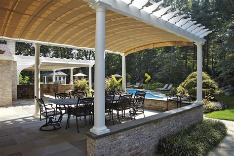 arched retractable awnings  oyster bay shadefx canopies