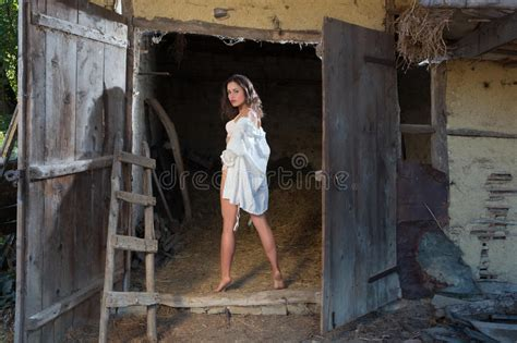 Young Girl In Old Barn Stock Photo