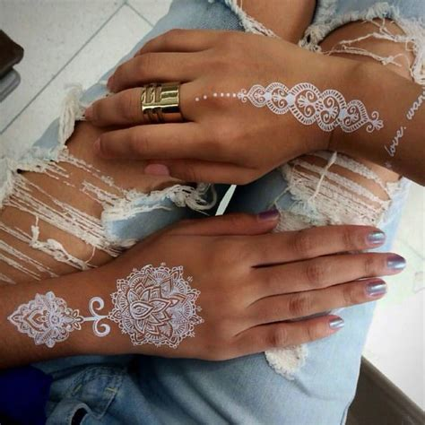 stunning white henna inspired tattoos