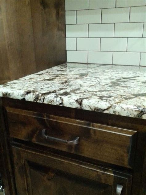 Delicatus normandy granite, biscuit subway tile backsplash