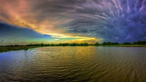 Amazing Sunset Behind Storm Clouds Widescreen Wallpaper