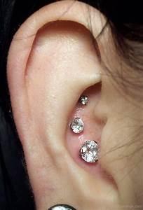 Closeup Tripple Conch Crystal Studs Ear Piercing
